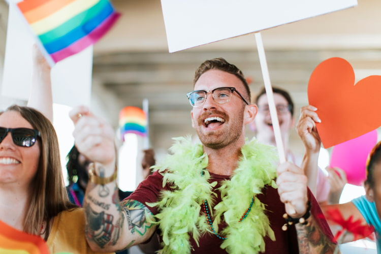 supporters cheer during a san francisco pride rally
