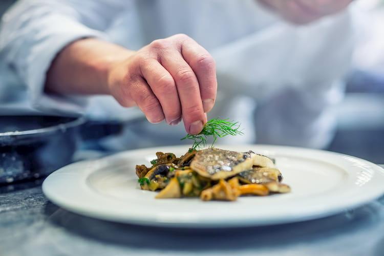 a chef prepares a fine seafood dish