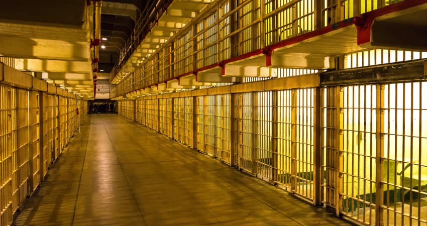 Interior of the Alcatraz cellhouse, rows upon rows of jaill cells stretching down a hallway