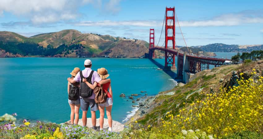 A group of people viewing the Golden Gate Bridge