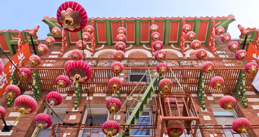 Red lanterns hang from an old building in Chinatown, San Francisco