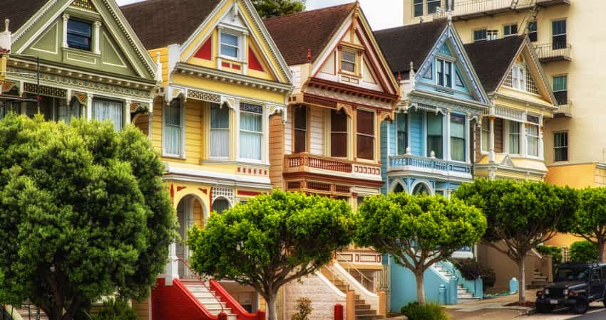 Brightly painted Victorian houses line a street in San Francisco