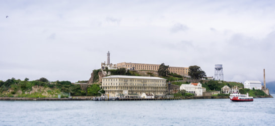 alcatraz island with ferries surrounding it