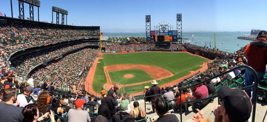 oracle park filled with baseball fans overlooking the bay